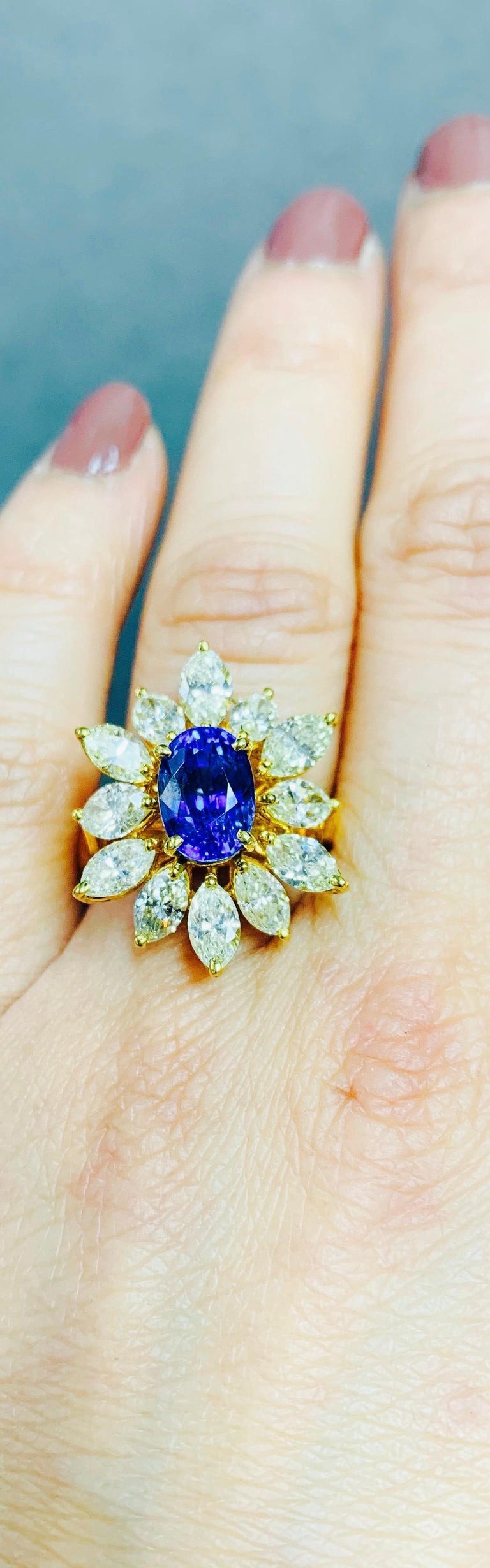 Contemporary Blue Sapphire and Yellow Diamond Ring in 18 Karat Yellow Gold For Sale