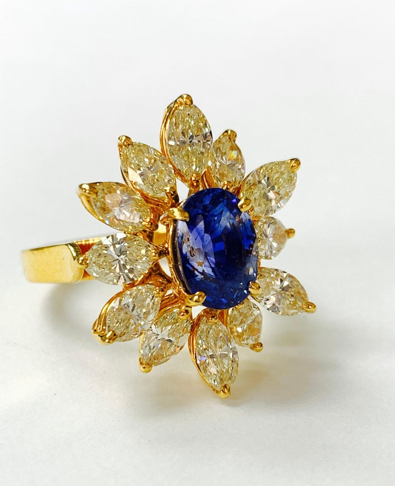 Women's Blue Sapphire and Yellow Diamond Ring in 18 Karat Yellow Gold For Sale