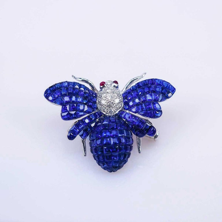 We use the top quality sapphire which make in invisible setting. We set the stone in perfection as we are professional in this kind of setting more than 40 years. The invisible is a highly technique .We cut and groove every stone .Therefore; we can