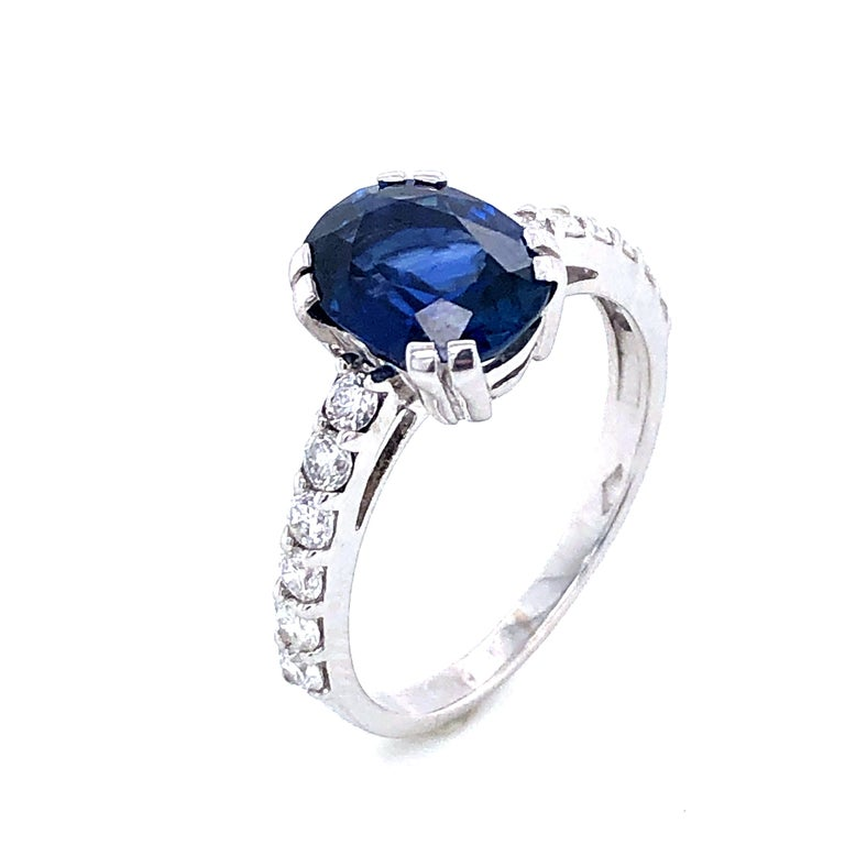 Blue Sapphire and Diamonds White Gold 18. k Ring Blue Sapphire Form C 2,38 Carat  12 Diamonds Color H 0.48 Carat French Size : 54 US Size : 6 3/4 British Size :  N
