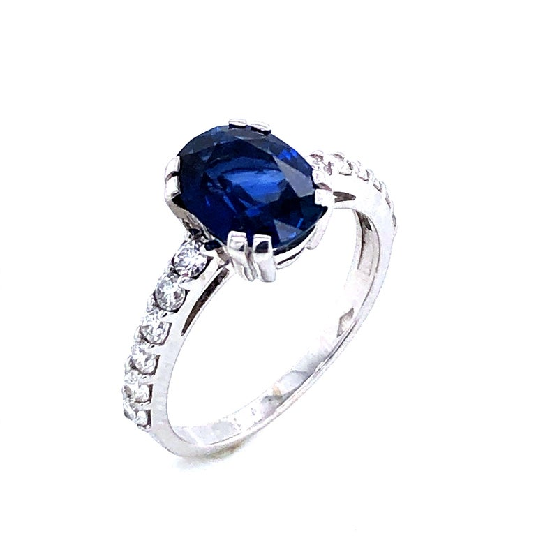 Oval Cut Blue Sapphire Ceylan and Diamonds on White Gold 18 Karat For Sale
