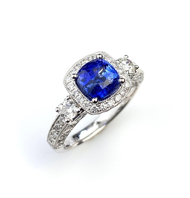 Cushion cut 1.78ct Blue Sapphire in an antique style 18kt white gold ring setting. Detailed with 0.73ct total of diamonds micro set around the centre gem and on the band. Current ring size 5 1/2. Complementary ring sizing up or down two sizes.