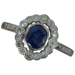 Blue Sapphire and Diamond 18 Carat White Gold Halo Cluster Ring