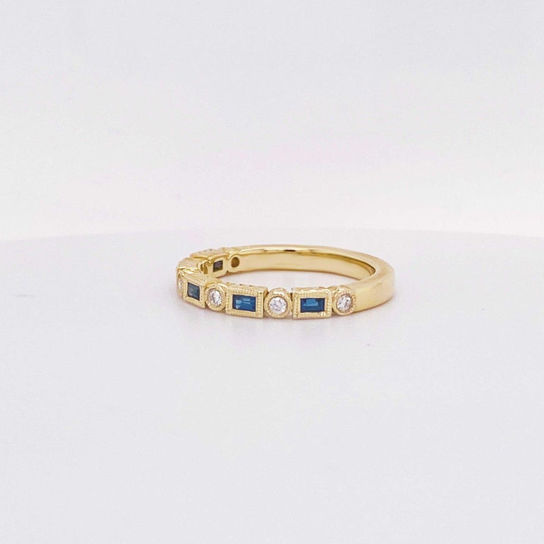 Blue sapphire and white diamonds have never looked better! This gemstone and diamond fashion band is a modern design with traditional stones. Set in 14 karat yellow gold the baguette blue sapphires are genuine gemstones set in a milgrain beaded