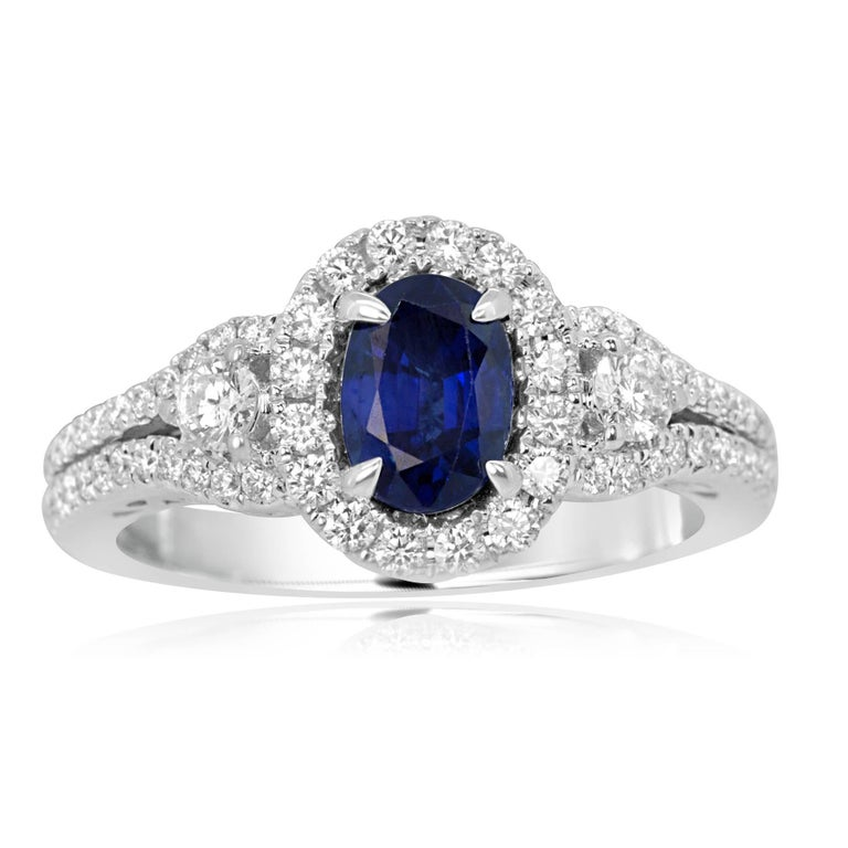 1.00 Carat Blue Sapphire Oval Encircled by Halo of White 0.47  Diamond  Carat Flanked by 2 White Diamond 0.15 Carat in 14K white Gold Two row shank Ring. Total Weight 1.62 Carat.