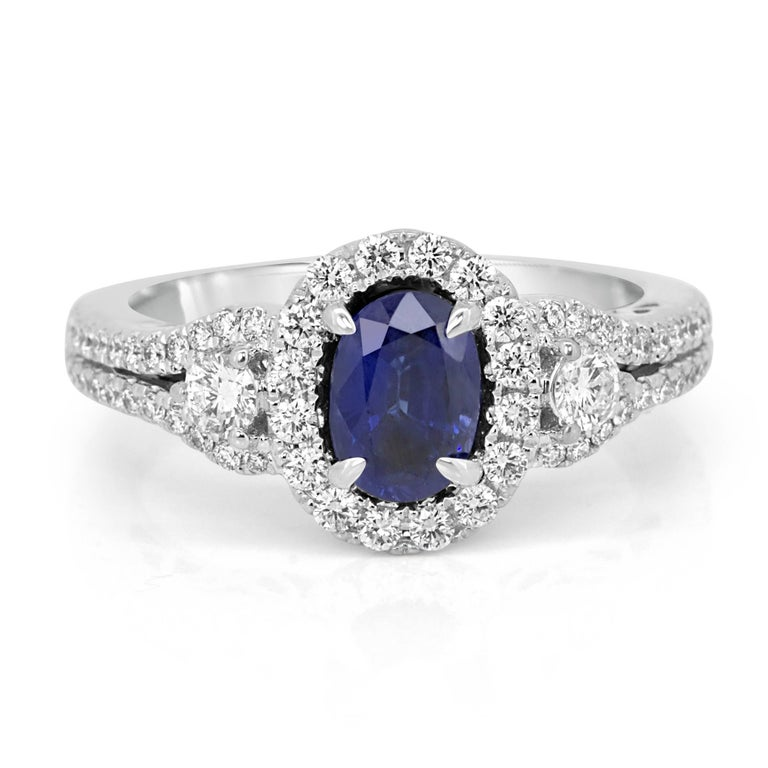 Modern Blue Sapphire Oval Diamond Halo Bridal Fashion Cocktail Three-Stone Gold Ring For Sale
