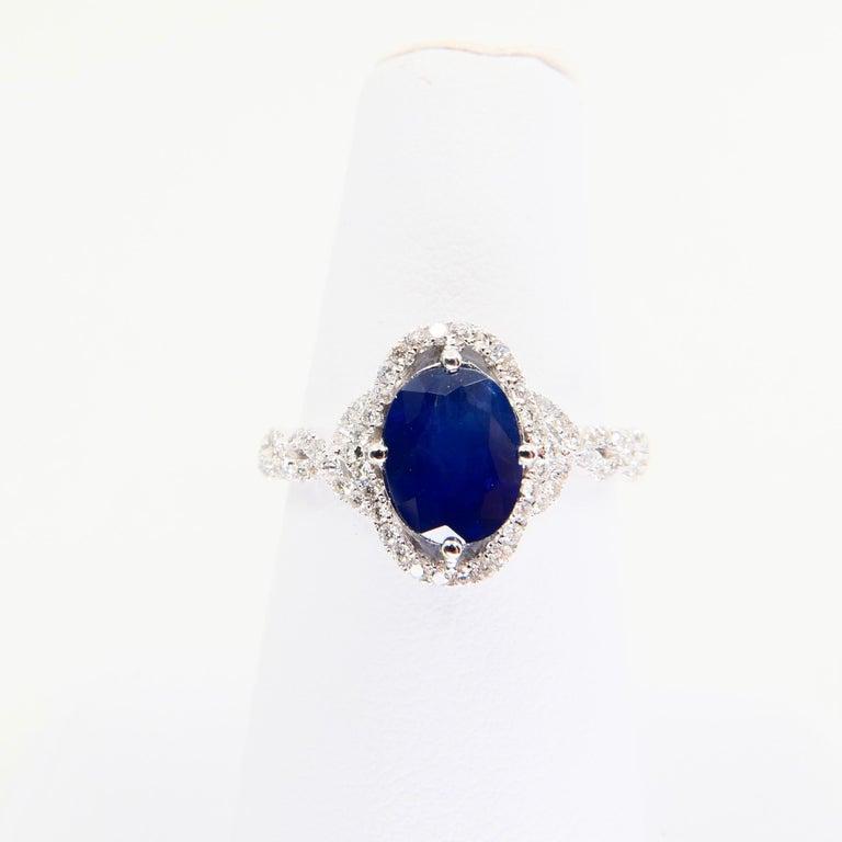 Blue Sapphire and Diamond Twist Ring, 18 Karat White Gold For Sale 6
