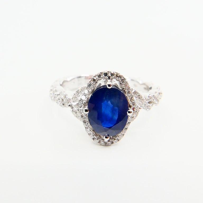 Women's Blue Sapphire and Diamond Twist Ring, 18 Karat White Gold For Sale