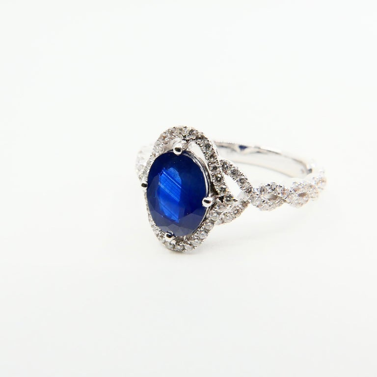 Blue Sapphire and Diamond Twist Ring, 18 Karat White Gold For Sale 1