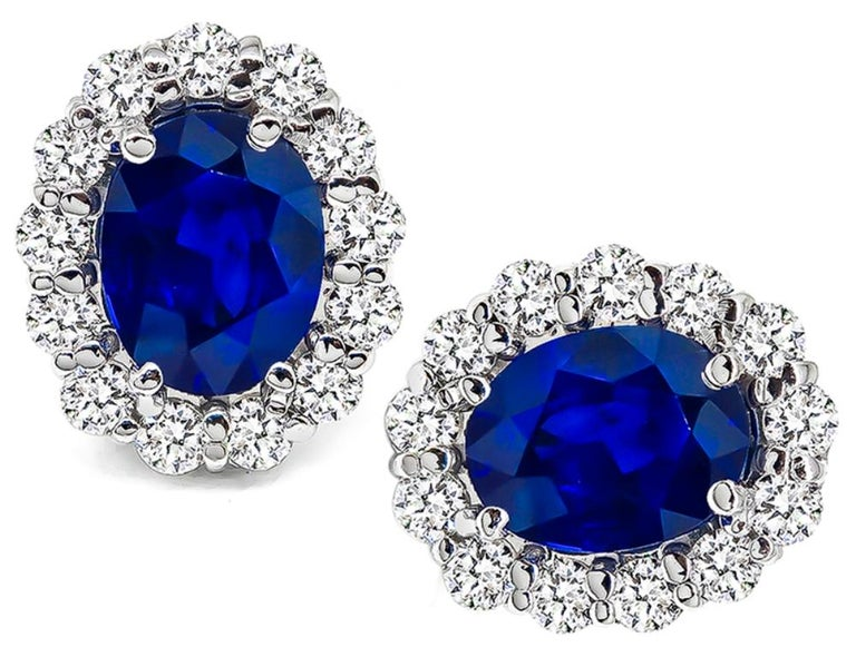 This stunning pair of 18k white gold earrings are centered with oval cut sapphires that weigh approximately 3.00ct. The sapphires are accentuated by sparkling round cut diamonds that weigh approximately 0.92ct. graded G-H color with VS clarity. The