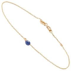 Armband aus Gelbgold von Allison Bryan mit blauem Saphir