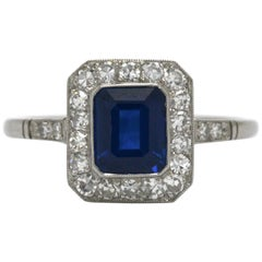Blue Sapphire Emerald Cut Platinum Art Deco Revival Diamond Halo Engagement Ring
