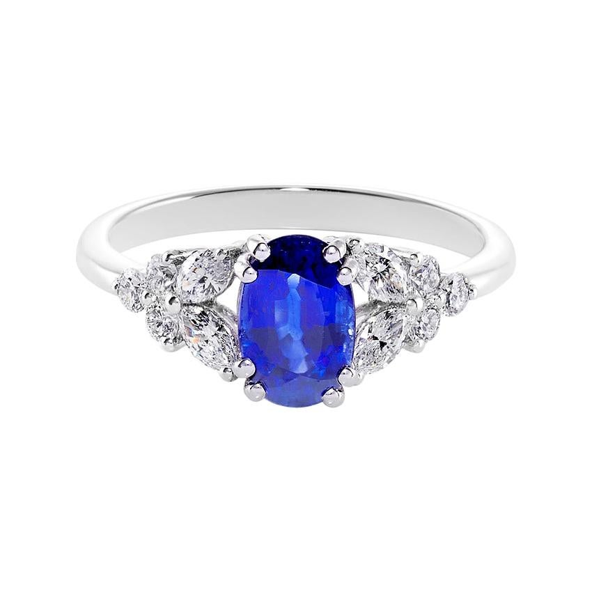 Blue Sapphire Engagement Ring with Marquise Cut Diamond in 18K White Gold