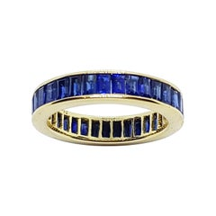 Blue Sapphire Eternity Ring Set in 18 Karat Gold Settings