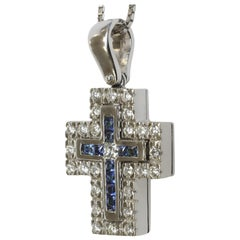 Blue Sapphire, Green Tsavorite and White Diamond Cross in 18 Karat White Gold