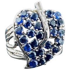 Blue Sapphire Leaf Ring with Diamonds in 14 Karat White Gold
