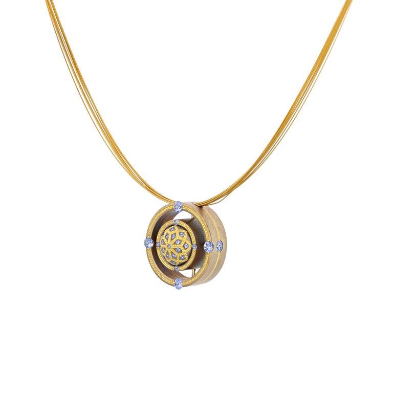 Round Cut Blue Sapphire Mandala Pendant in Bronze and 24 Karat Gold For Sale