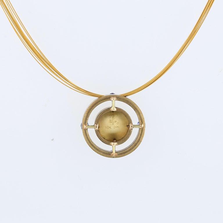 Women's Blue Sapphire Mandala Pendant in Bronze and 24 Karat Gold For Sale