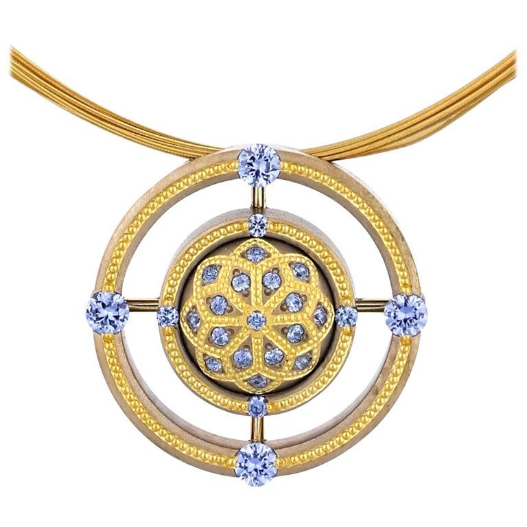 Blue Sapphire Mandala Pendant in Bronze and 24 Karat Gold For Sale