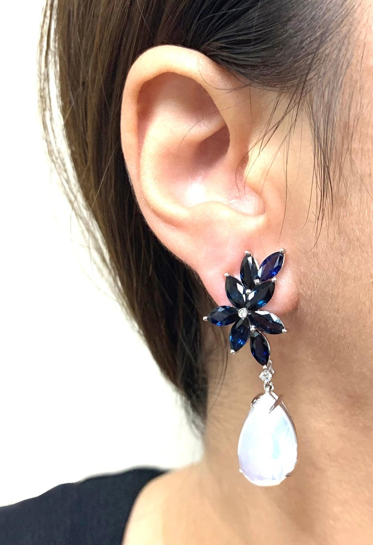 STYLE #: JE0326  Blue Sapphire Marquise with Moon Quartz Pear Shape Cabochon Cluster Earrings in White Gold. With omega back and Detachable Pear Shape Cabochon, from 'G-One' Collection   Stone Size: 8 x 4 mm (Sapphire), 19 x 12 mm (Moon