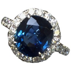Blue Sapphire Oval and Diamond Cocktail Ring in 18 Karat White Gold