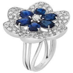 Blue Sapphire Oval and Diamond Flower Cocktail Ring in 18 Karat White Gold