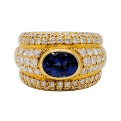 Blue Sapphire Oval and White Diamond Cocktail Ring in 18 Karat Yellow Gold