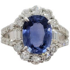 Blue Sapphire Oval and White Diamond Cocktail Ring in Platinum
