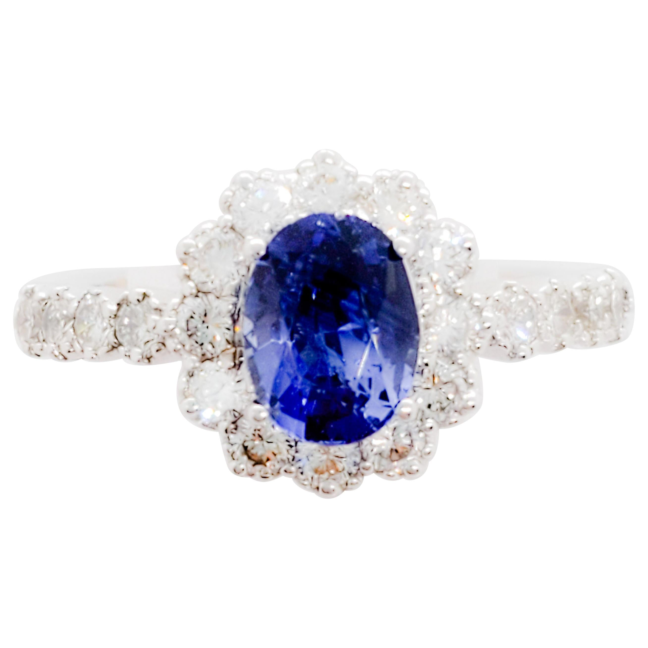 Blue Sapphire Oval and White Diamond Ring in 18 Karat White Gold