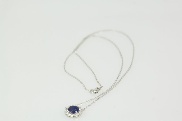 This Blue Sapphire Pendant with Diamond surround is simple sweet but packs a punch.  The Sapphire is 12.49mm round and weights 1.65 Carats, the Diamonds weight 0.80 carats and is stamped 750, 18K.  The gross weight is 3.2 grams.  This is new and