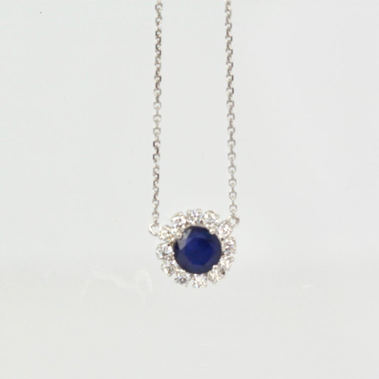 Aesthetic Movement Blue Sapphire Pendant Necklace with Diamond Surround For Sale