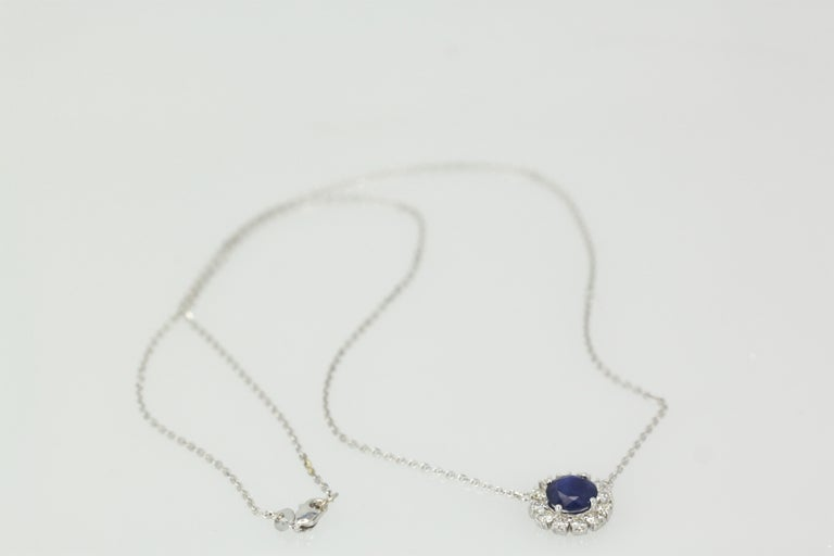 Round Cut Blue Sapphire Pendant Necklace with Diamond Surround For Sale