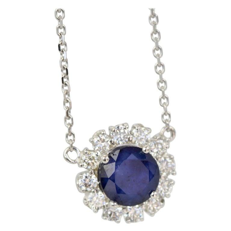 Blue Sapphire Pendant Necklace with Diamond Surround For Sale