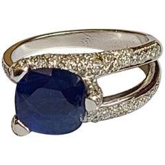 Blue Sapphire Ring Set in 18 Karat Gold with Diamonds