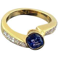 Blue Sapphire Ring with Diamonds in 14 Karat Yellow Gold