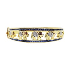Blue Sapphire with Cabochon Ruby and Diamond Bangle Elephant in 18K Gold