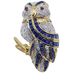 Blue Sapphire with Diamond and Ruby Owl Brooch Set in 18 Karat Gold Settings