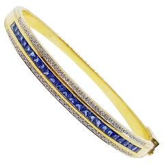 Blue Sapphire with Diamond Bangle Set in 18 Karat Gold Settings