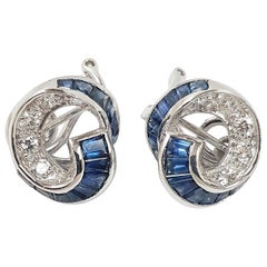 Blue Sapphire with Diamond Earrings Set in 18 Karat White Gold Setting