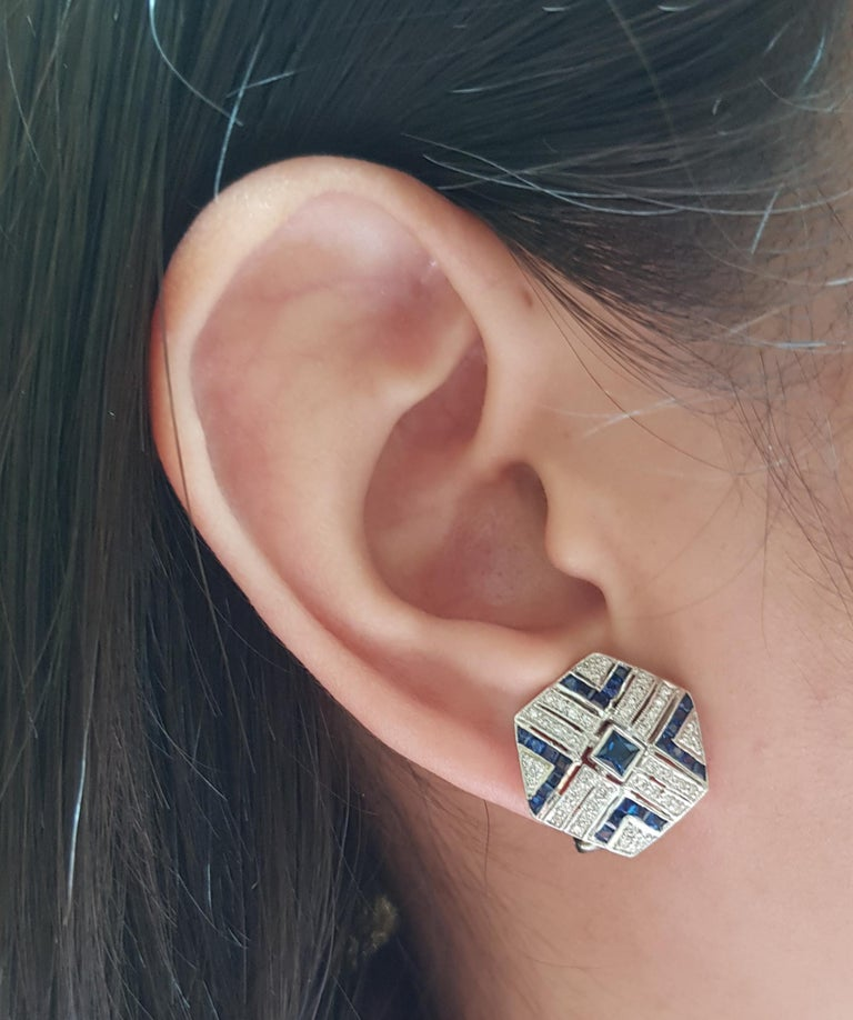 Blue Sapphire 2.0 carats with Diamond 1.12 carats Earrings set in 18 Karat White Gold Settings  Width:  1.7 cm  Length: 1.9 cm Total Weight: 8.62 grams