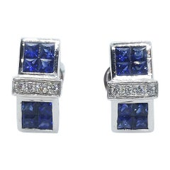 Blue Sapphire with Diamond Earrings Set in 18 Karat White Gold Settings