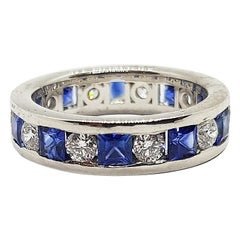 Blue Sapphire with Diamond Eternity Ring Set in 18 Karat White Gold Settings