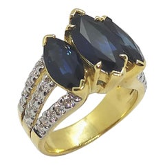 Blue Sapphire with Diamond Ring Set in 18 Karat Gold Settings