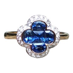 Blue Sapphire with Diamond Clover Ring Set in 18 Karat Gold Settings