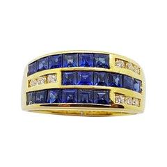 Blue Sapphire with Diamond Ring Set in 18 Karat Gold Settings