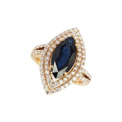Marquise Blue Sapphire with Diamond Ring Set in 18 Karat Rose Gold Settings