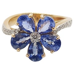 Blue Sapphire with Diamond Ring Set in 18 Karat Rose Gold Settings