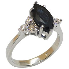 Blue Sapphire with Diamond Ring Set in 18 Karat White Gold Settings