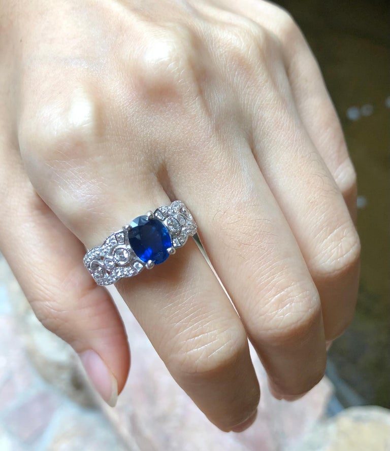 Blue Sapphire 1.82 carats with Diamond 0.49 carat Ring set in 18 Karat White Gold Settings  Width:  0.6 cm  Length:  0.9 cm Ring Size: 56 Total Weight: 6.37 grams