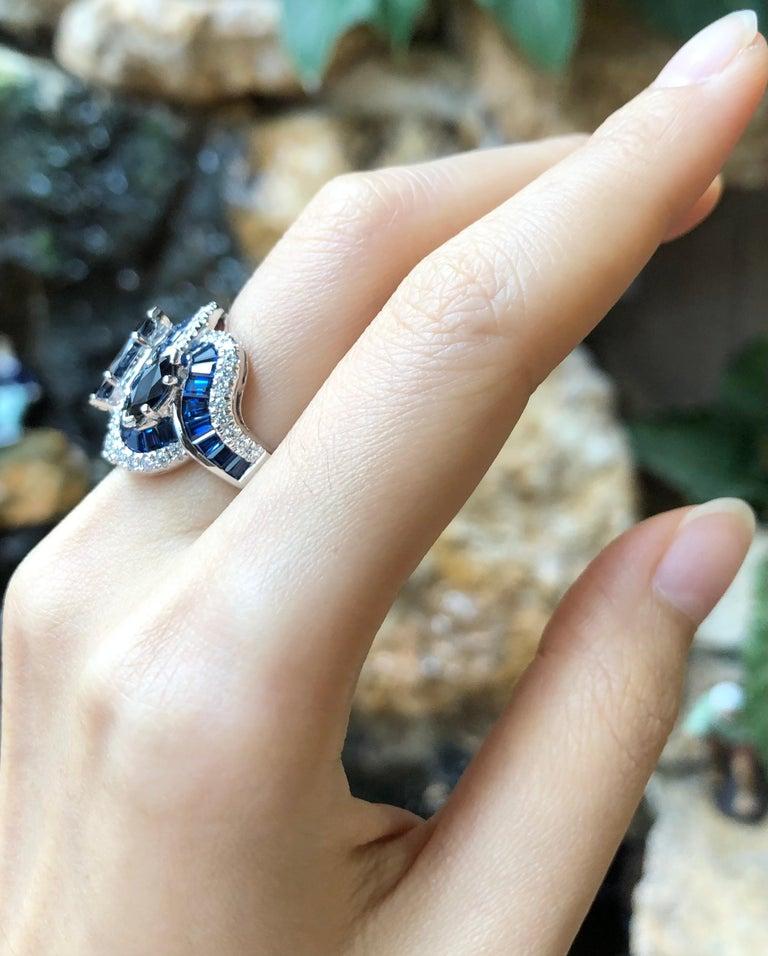 Blue Sapphire 3.48 carats with Blue Sapphire 7.92 carats and Diamond 0.57 carat Ring set in 18 Karat White Gold Settings  Width:  2.0 cm  Length:  2.0 cm Ring Size: 52 Total Weight: 11.33 grams